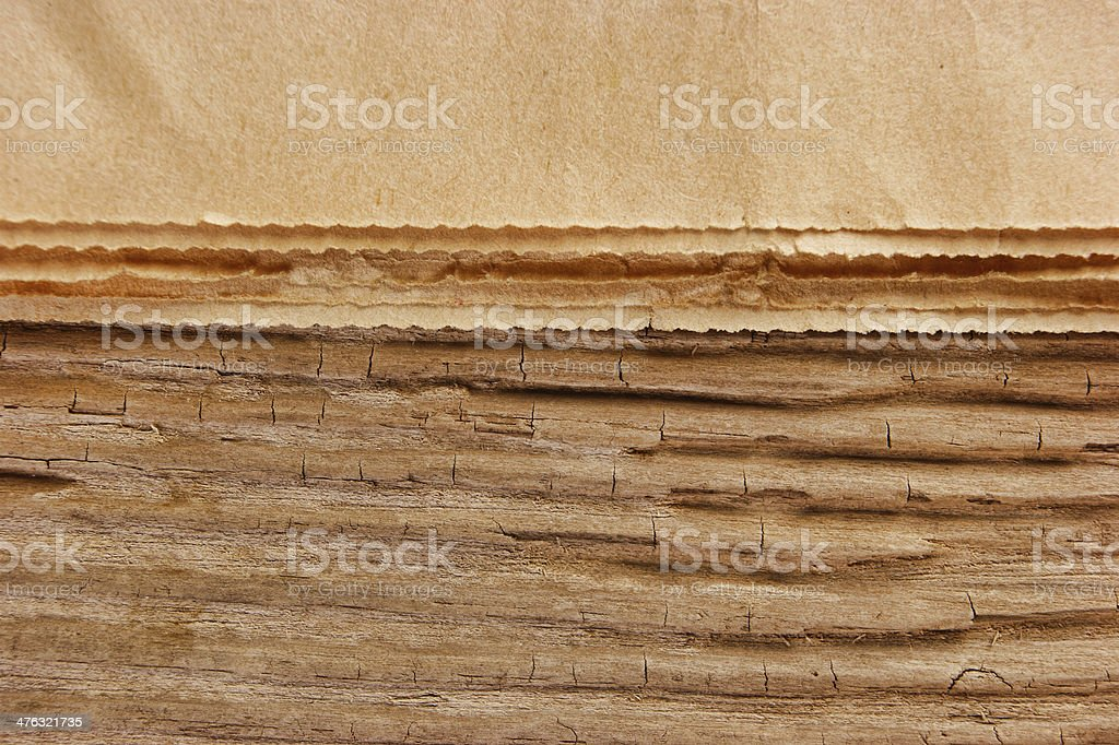 edge of the old newspaper on a wooden background royalty-free stock photo