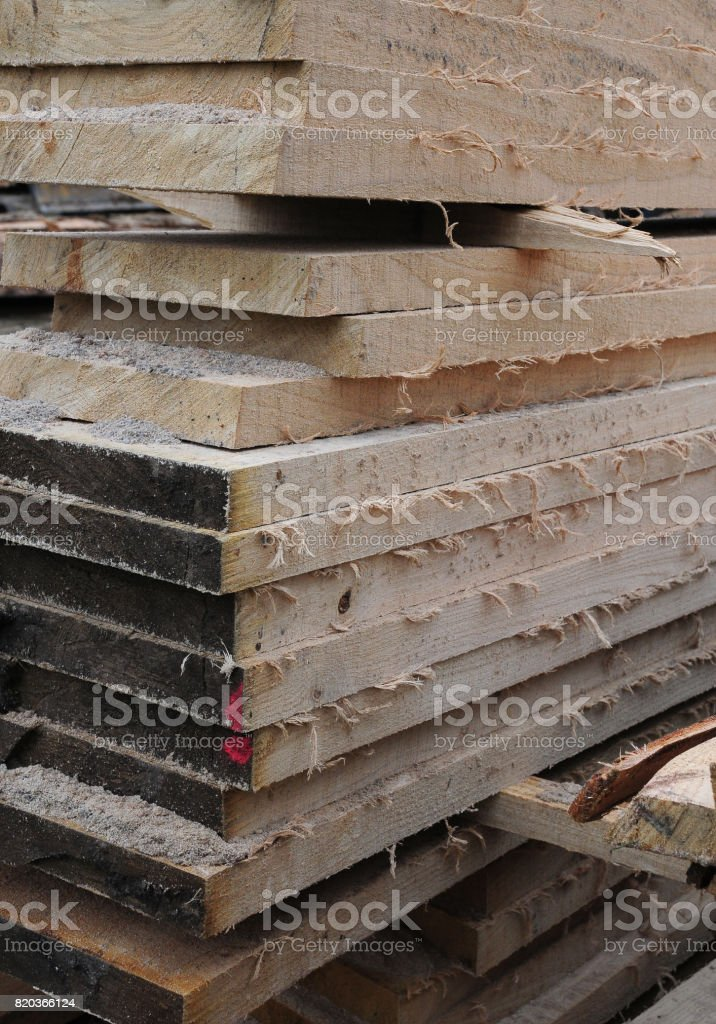 Edges of rough cut timber planks stacked up stock photo