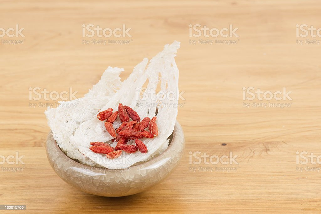 Edible bird's nest with chinese wolfberry fruits royalty-free stock photo
