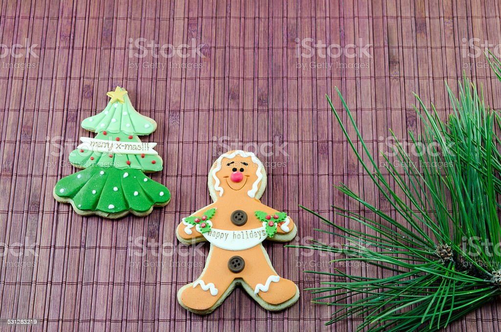 Edible gingerbread and a christmas tree royalty-free stock photo