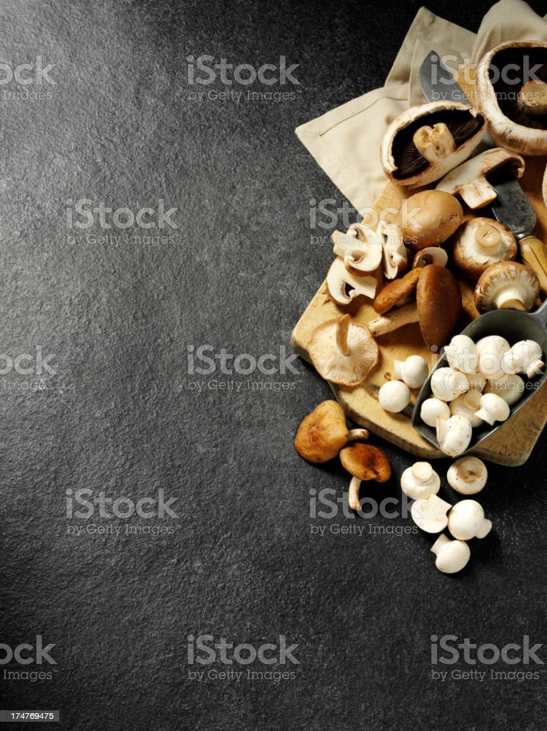 Edible Mushrooms on a Wooden Chopping Board stock photo