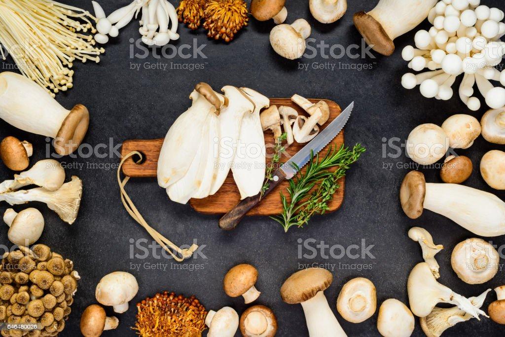 Edible Mushrooms with Chopping Board stock photo