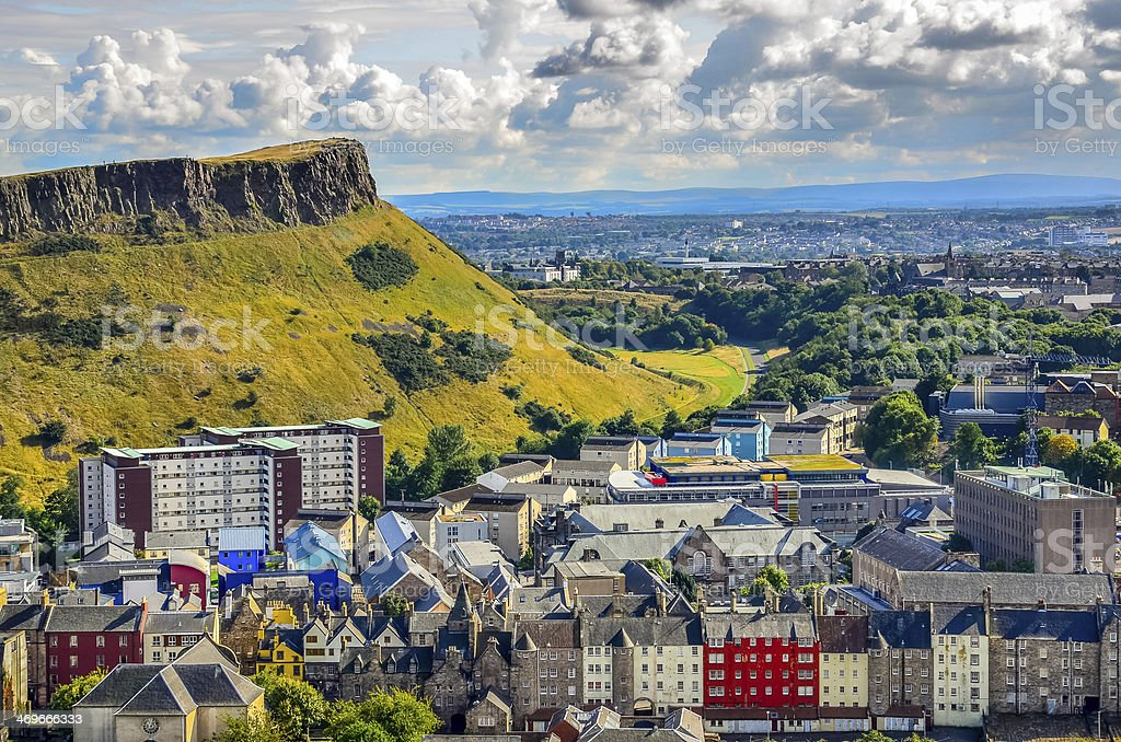 Edinburgh citiscape view with houses and Salisbury crags, Scotla stock photo