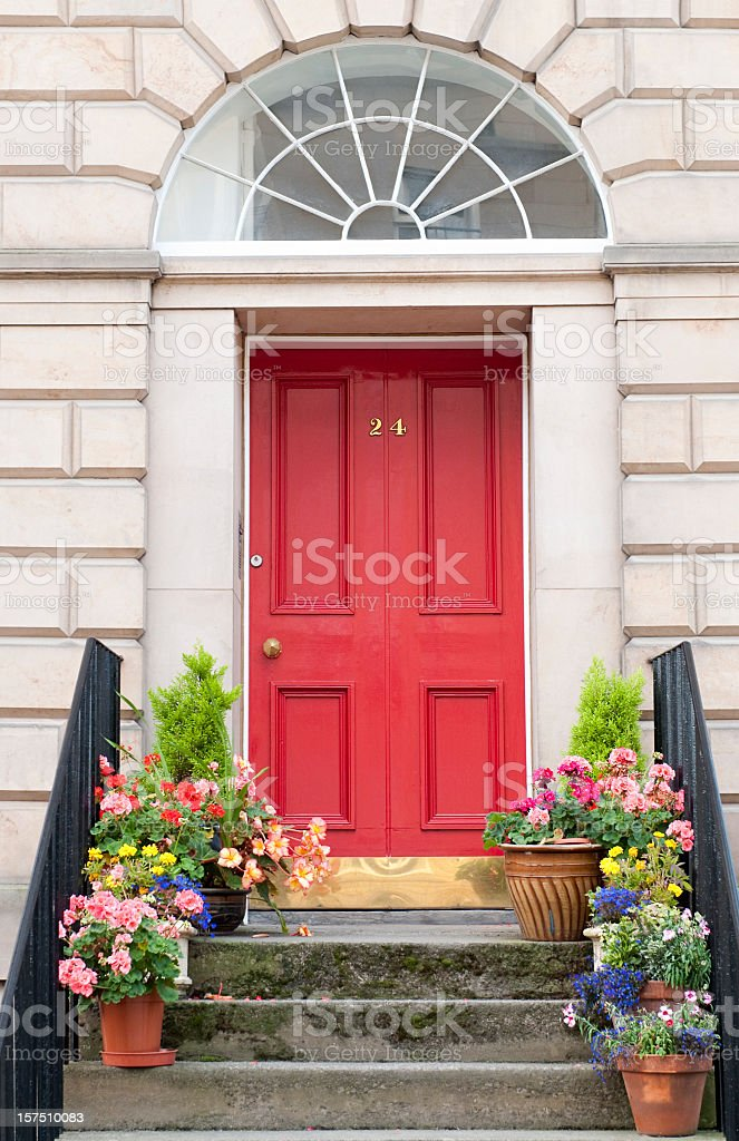 Flowers decorating a shared entrance to flats / apartments in...