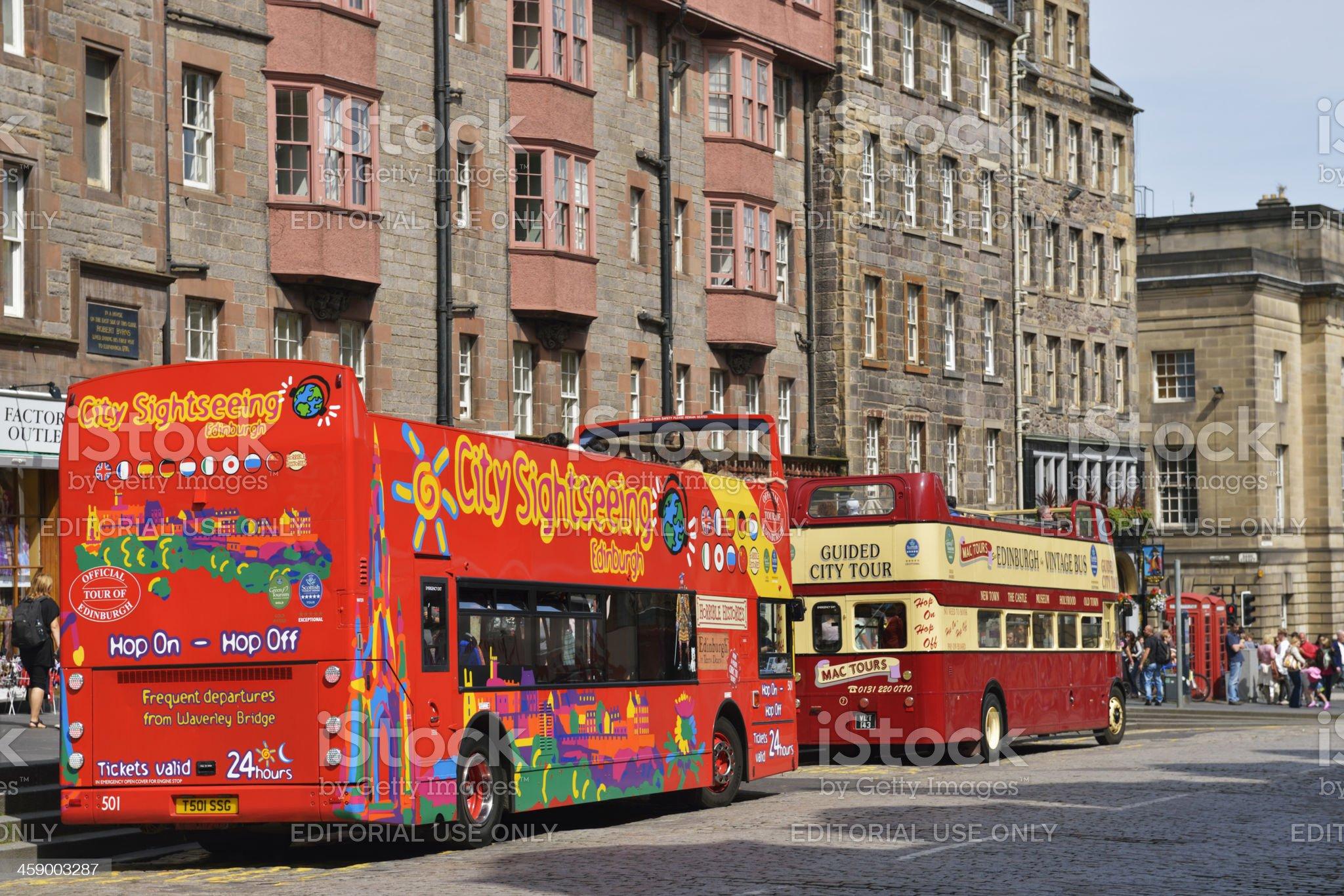 Edinburgh tour buses on the Royal Mile royalty-free stock photo