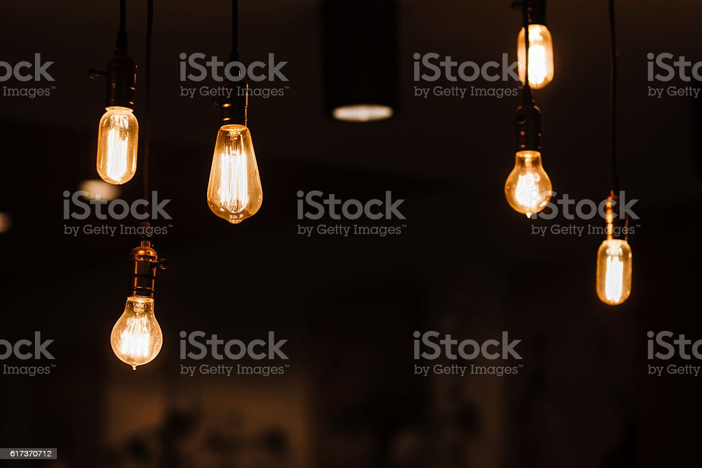 Edison lamps hanging from the ceiling stock photo