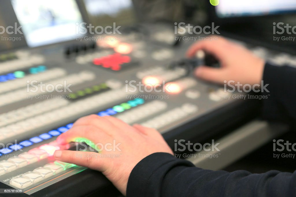 TV editor working with audio video broadcasting mixete stock photo