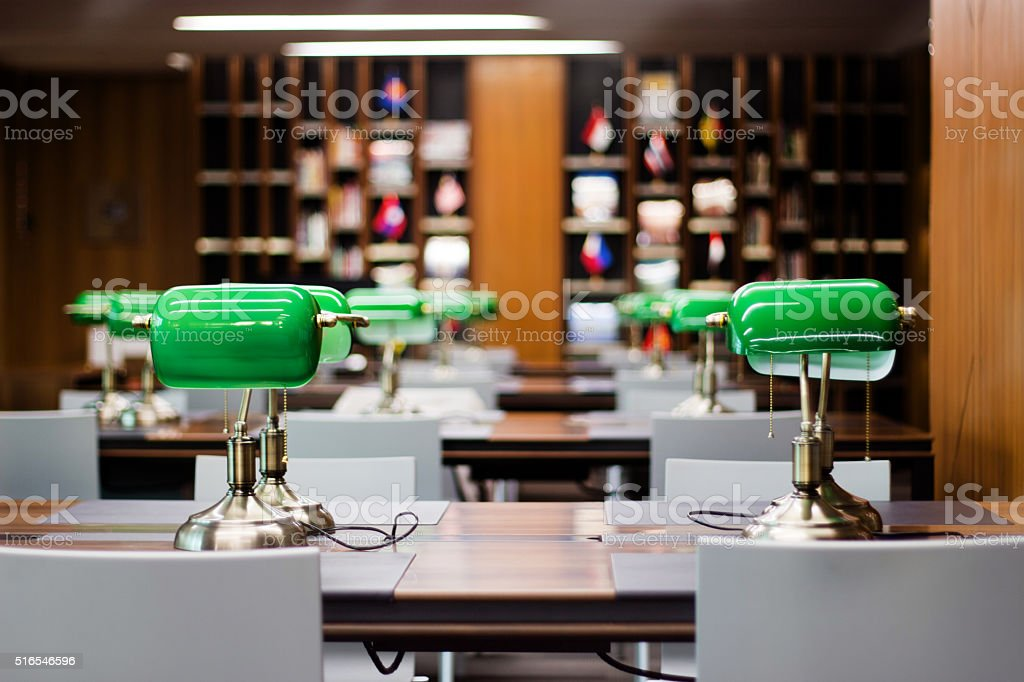 Editorail green lamp in library desk At C-Asean stock photo