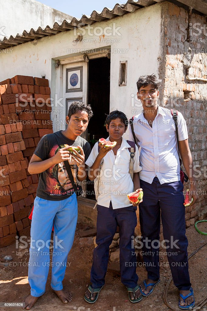 Editorial illustrative image. Teenagers in the street, India stock photo