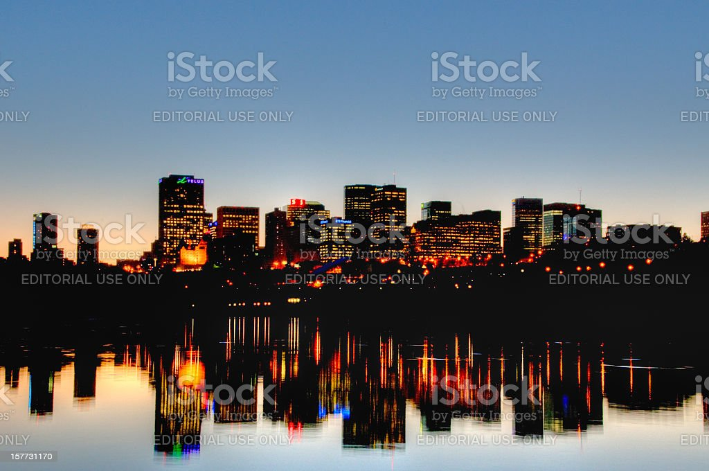 Edmonton skyline at sunset reflected in river stock photo