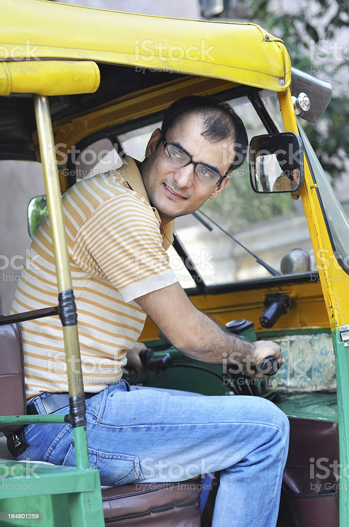 Educated man driving auto rickshaw royalty-free stock photo