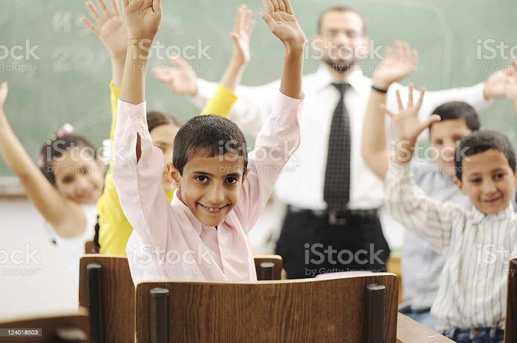 Education activities in classroom at school, children with teacher stock photo