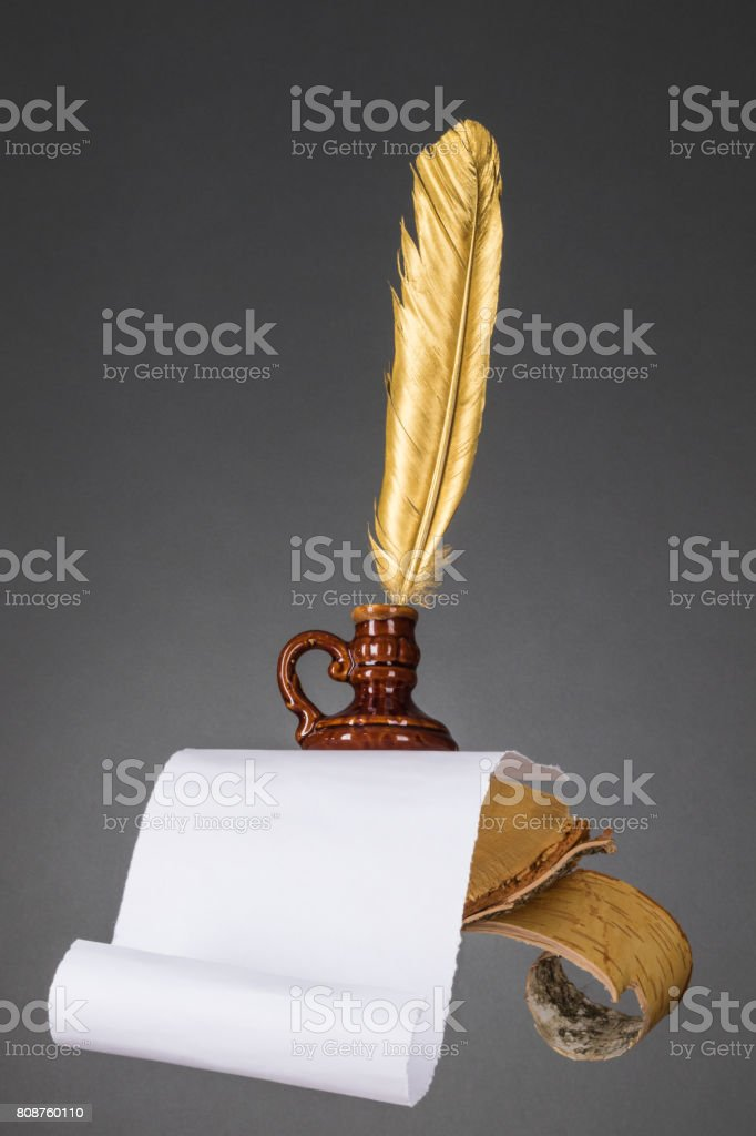 Education and literature concept. Abstract wood desktop with paper and gold quill pen of a writer, poet, teacher, professor stock photo