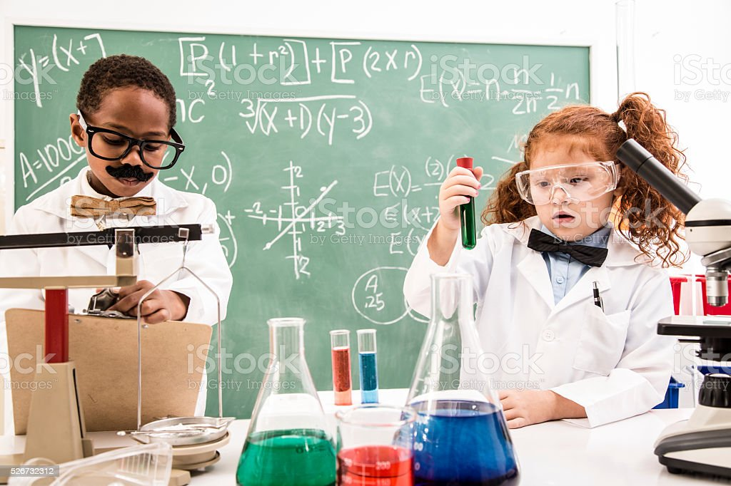 Education:  Children chemists, scientists in their lab doing experiments. stock photo