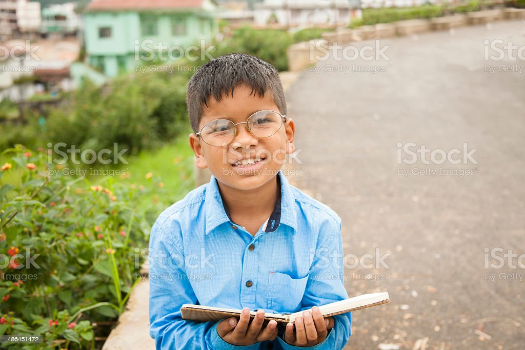 Education. Children. Little boy living in India ready for school. stock photo