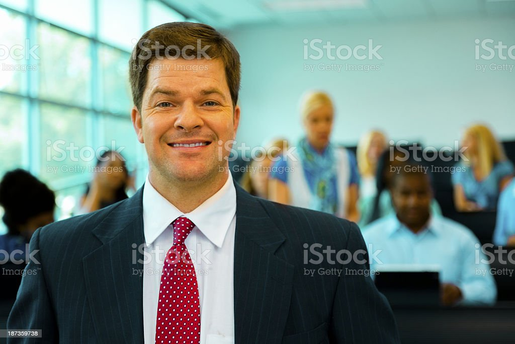 Education:  College students with professor in lecture hall. royalty-free stock photo