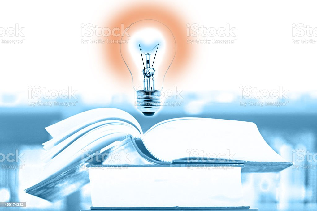 Education concept, book and light bulb stock photo