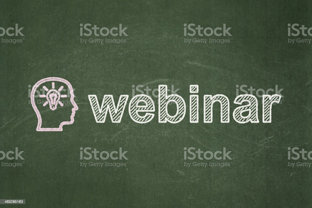 Education concept: Head With Lightbulb and Webinar on chalkboard background royalty-free stock photo