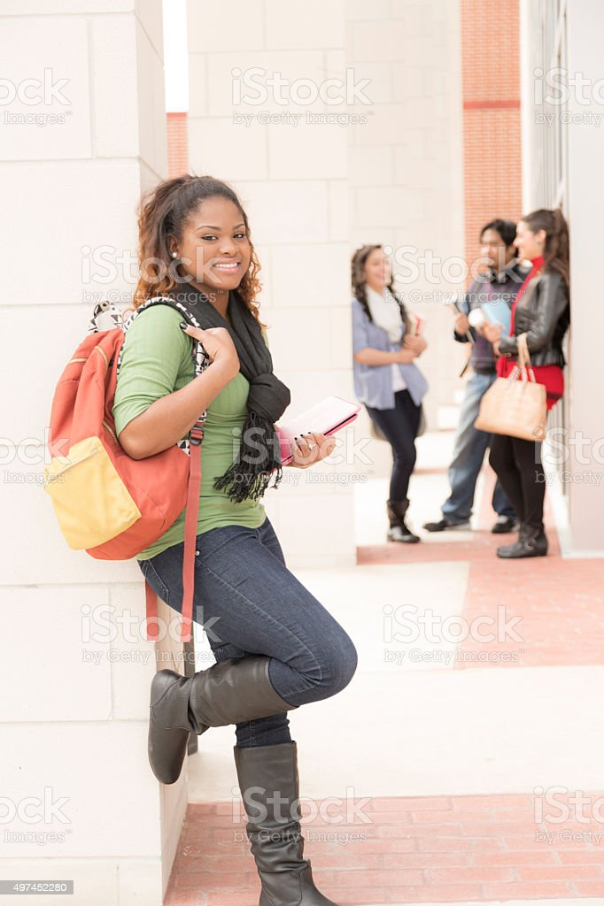 Education: Confident, African descent female college student on campus. stock photo