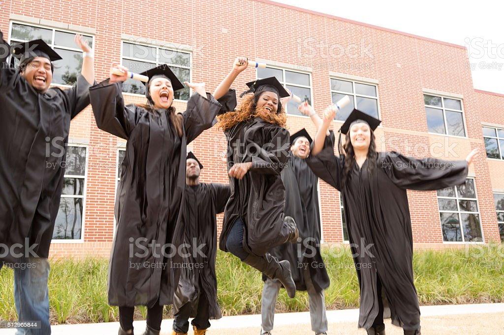 Education: Friends show excitement after college graduation. stock photo