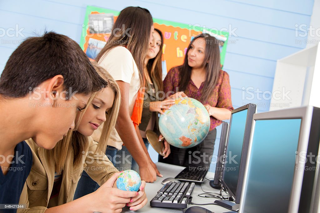 Education: High school students in computer lab. Geography. stock photo