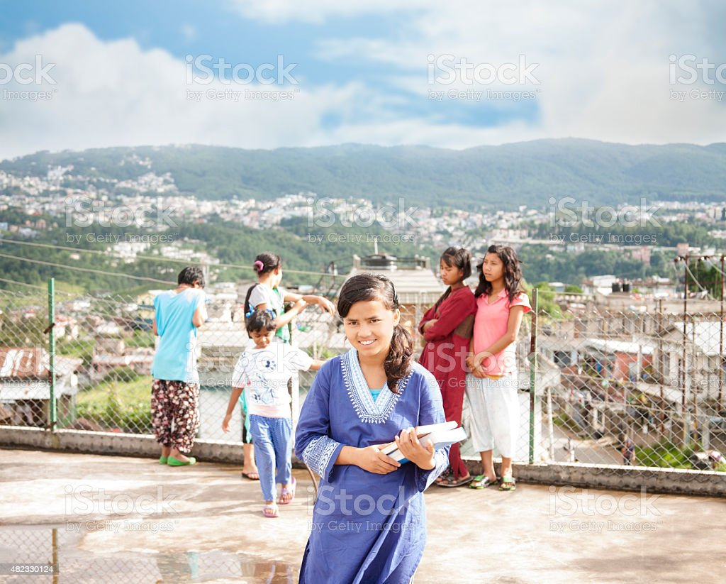 Education. High school students prepare for school in Shillong, India. stock photo