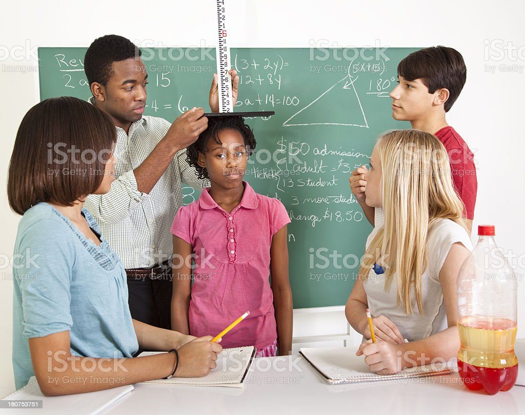 Education:  Junior High students studying measurements in science class royalty-free stock photo