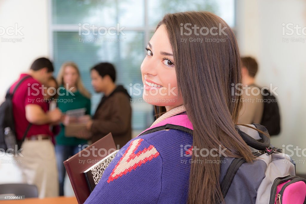 Education: Latin college student prepares for class. royalty-free stock photo