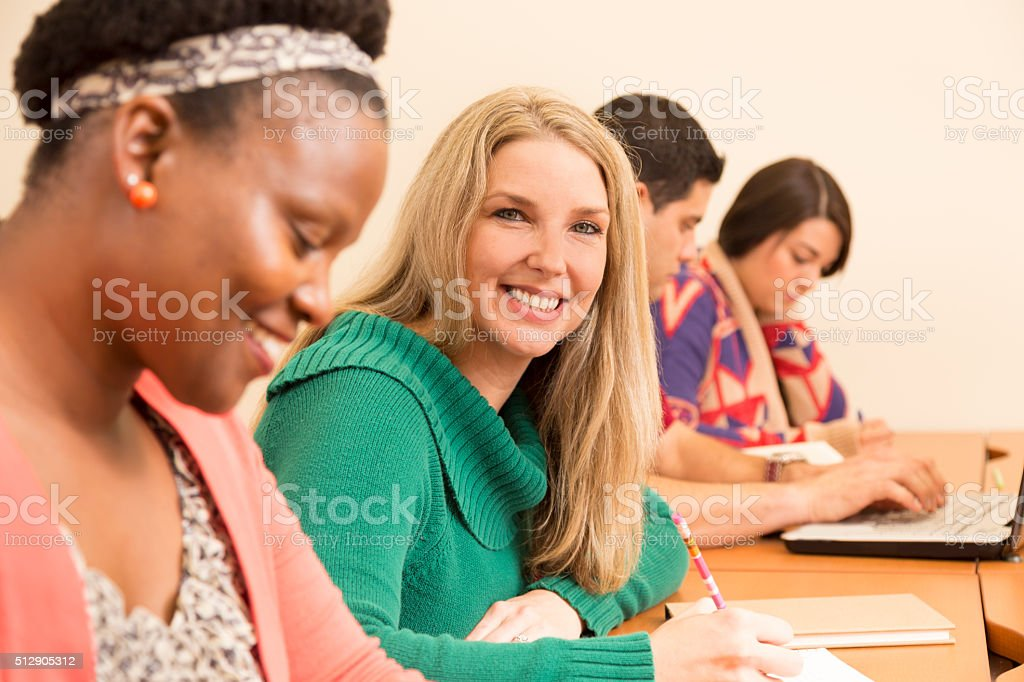 Education: Mature college students take test in classroom. stock photo