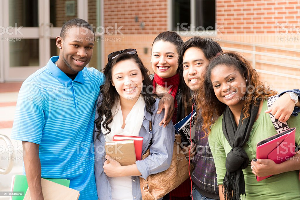 Education: Multi-ethnic group of college friends hang out before class. stock photo