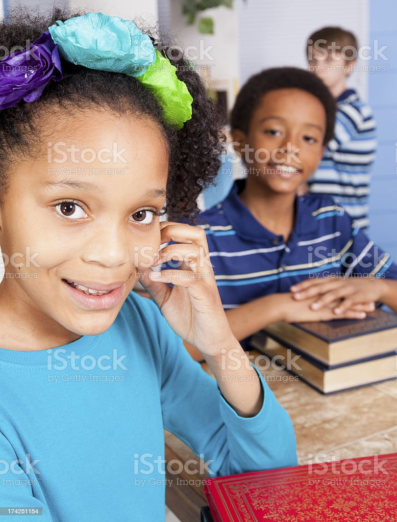 Education:  Multi-ethnic students in school library. royalty-free stock photo