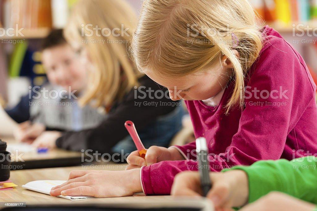 Education - Pupils at school doing homework stock photo