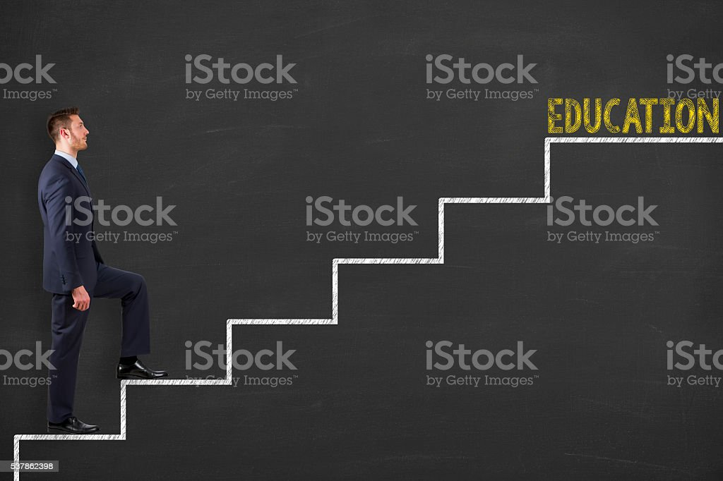 Education Stages on Chalkboard Background stock photo