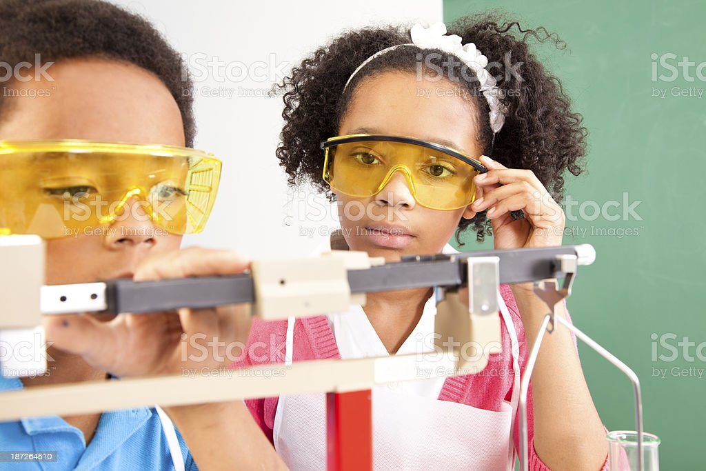 Education: Students in chemistry class conducting an experiment. royalty-free stock photo