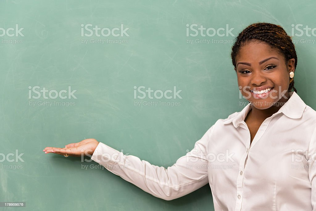 Education:  Teacher or student at blank chalkboard. royalty-free stock photo