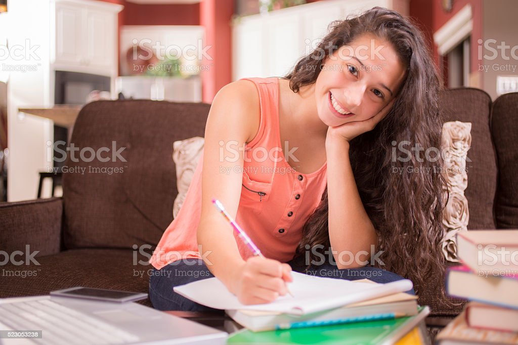 Education.  Teenage girl studying at home. Student. Homework. stock photo
