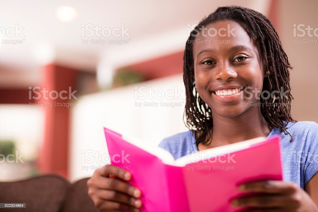 Education.  Teenage girl studying, reading at home. Homework. stock photo