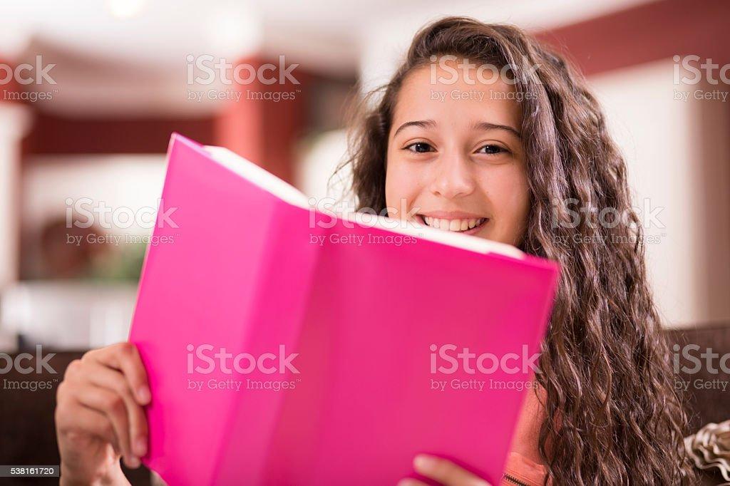 Education.  Teenage girl studying, reading at home. Homework. stock photo