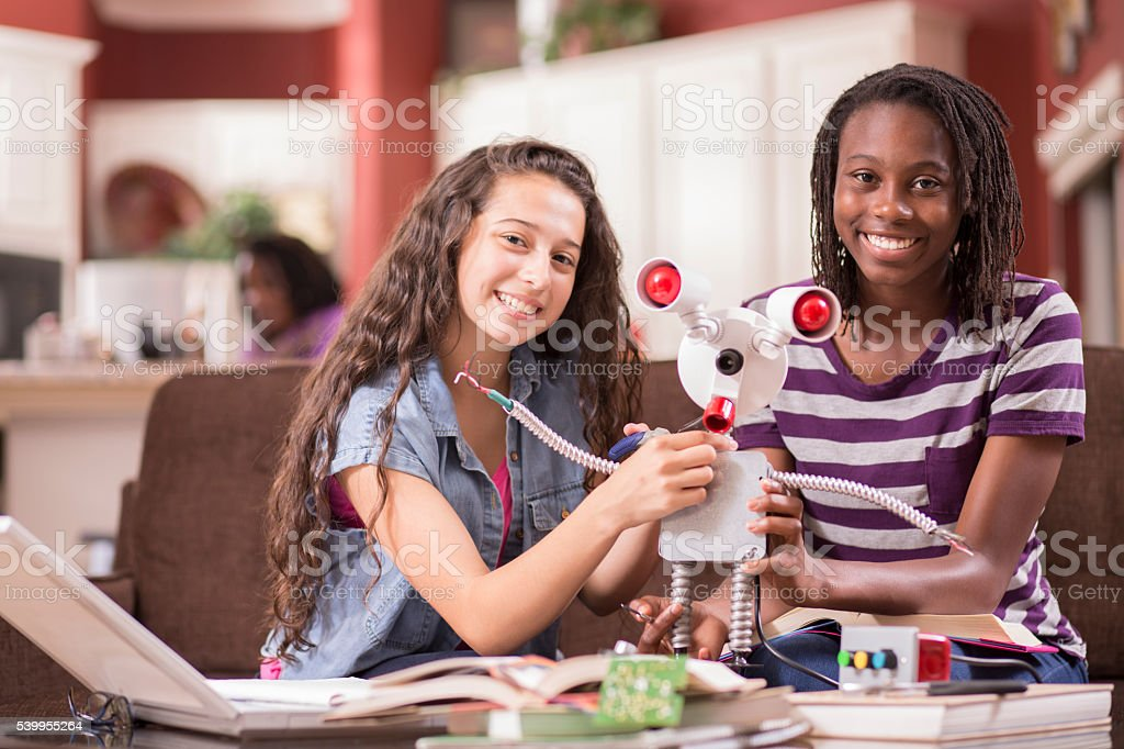 Education.  Teenage girls studying science, engineering at home. Homework. stock photo
