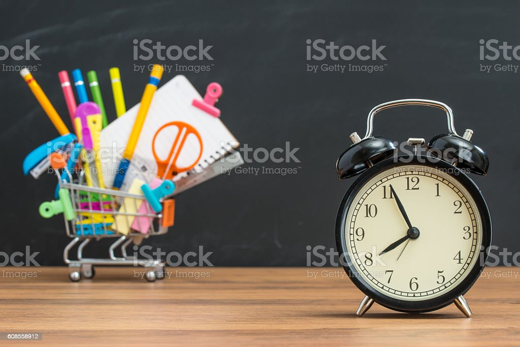 education time for student Back to School with alarm clock stock photo