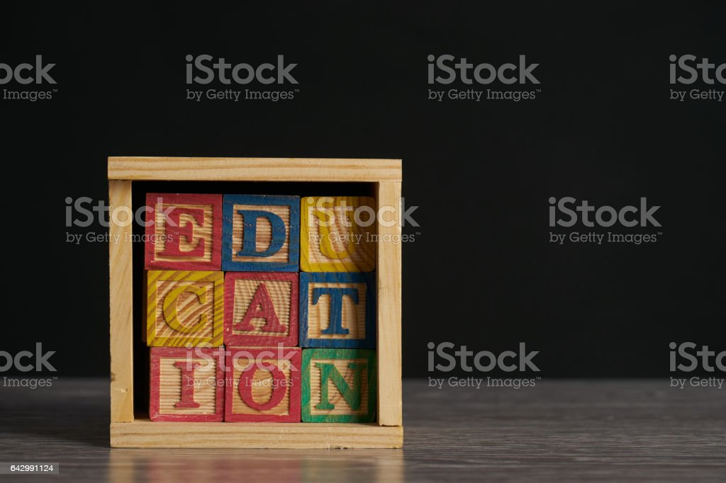 Education word on wooden cubes with letters in wooden box stock photo