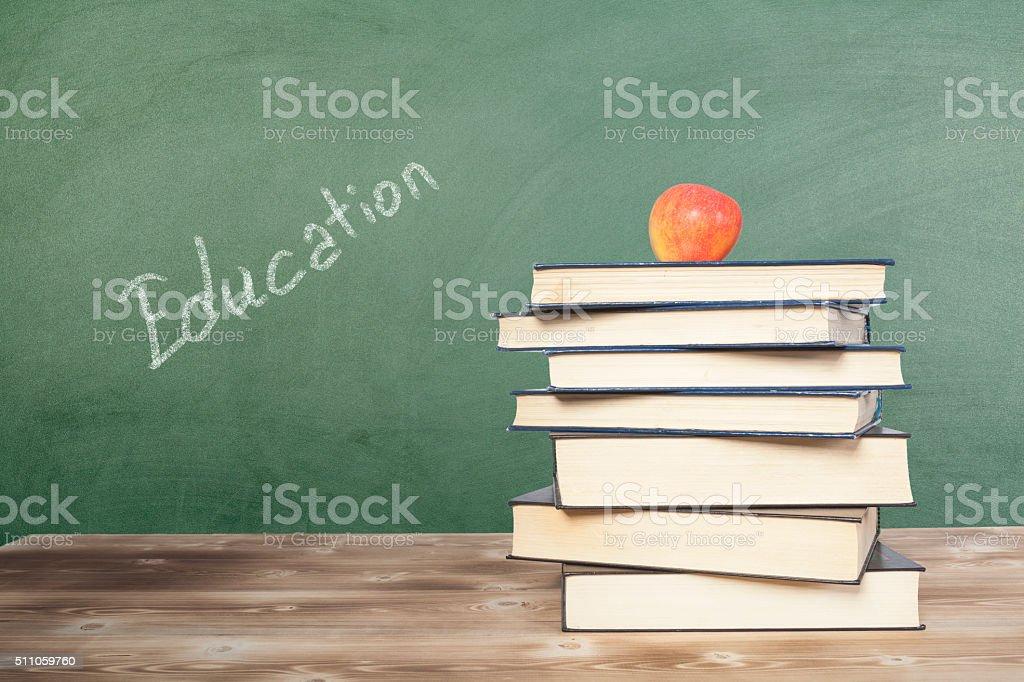 Education Writen with book on Chalkboard stock photo