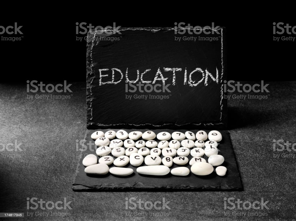 Education Written on a Prehistoric Computer Laptop royalty-free stock photo