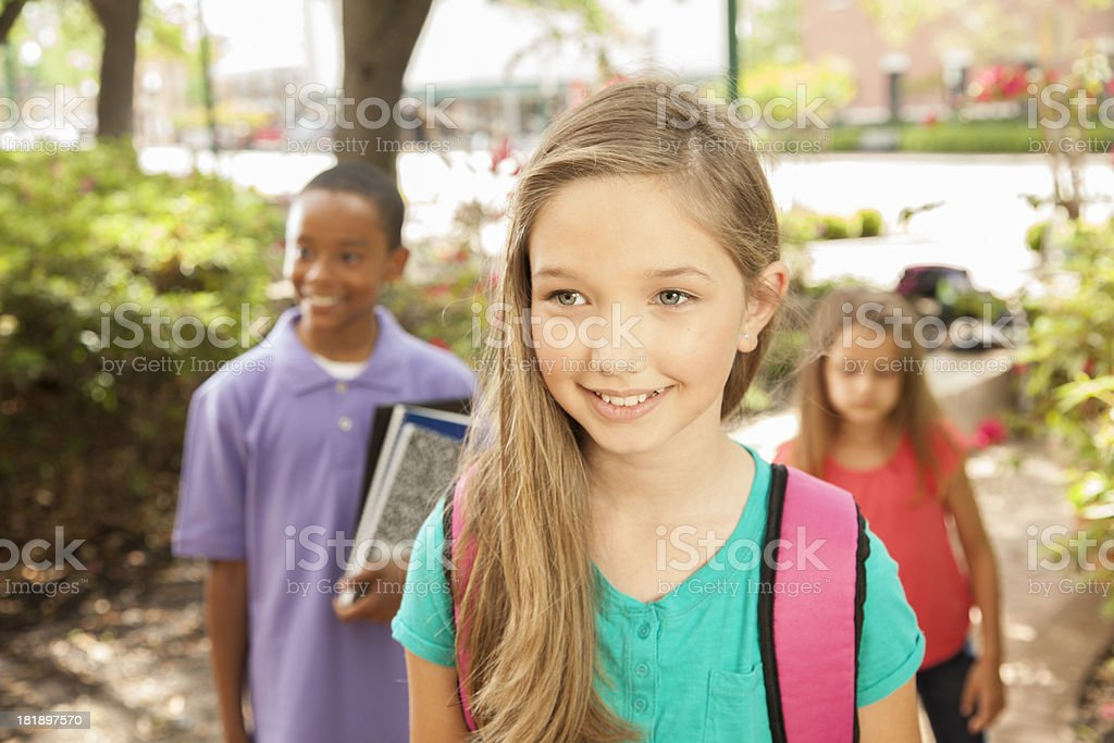 Education:  Young elementary age students walking to school royalty-free stock photo