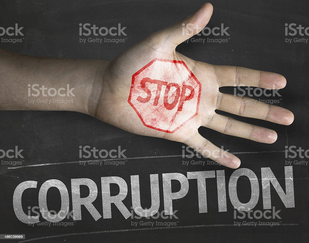 Educational and Creative composition with the message Stop Corruption stock photo
