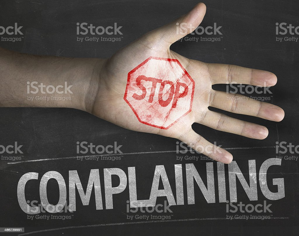 Educational and Creative composition with the message Stop Complaining stock photo