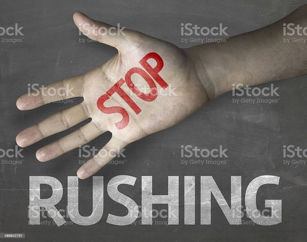 Educational and Creative composition with the message Stop Rushing stock photo