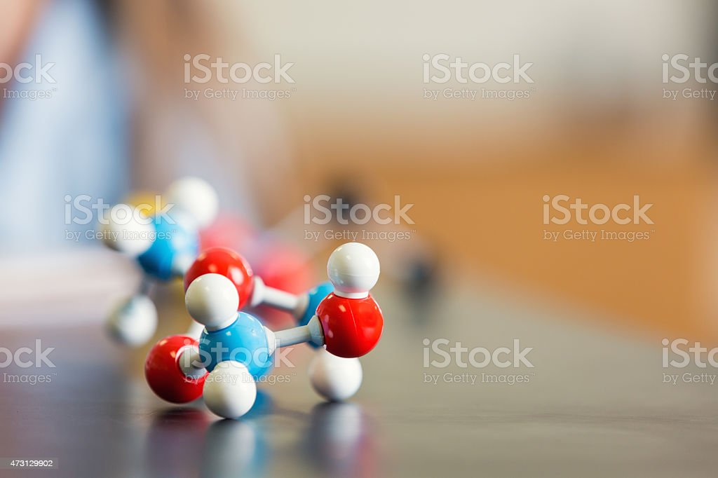 Educational science toy model of molecule or atom on desk stock photo