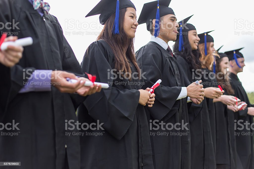 Educaton: Diverse group of college students graduating stock photo