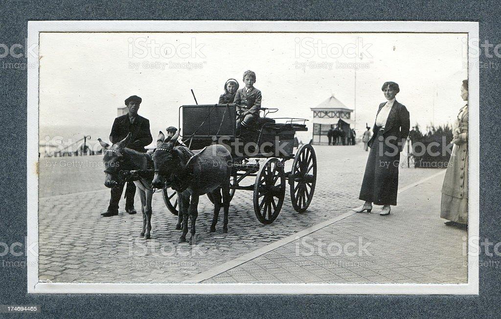 Edwardian Holiday Children and Donkey Carriage - Vintage Photograph stock photo